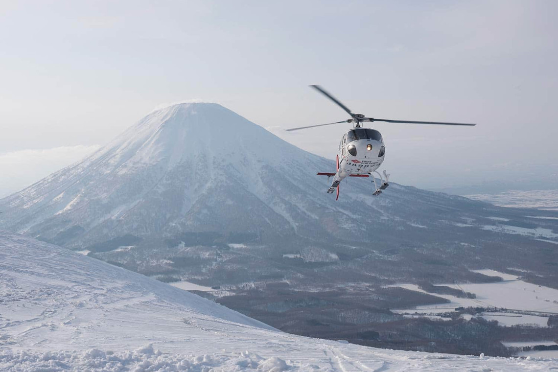 Heli skiing Japan. Book your heli ski experience with Stoked Adventure Hostel. http://stokednisekohostel.com/vendor/heli-skiing-japan/